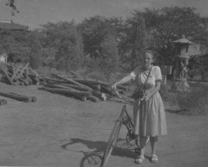 Photo of Chapin with her bicycle in China, ca.1930