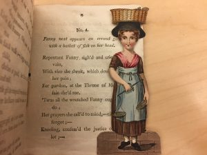 A paper doll is tucked inside the book, The History of Little Fanny, from the Ellery Yale Wood Collection in Special Collections.