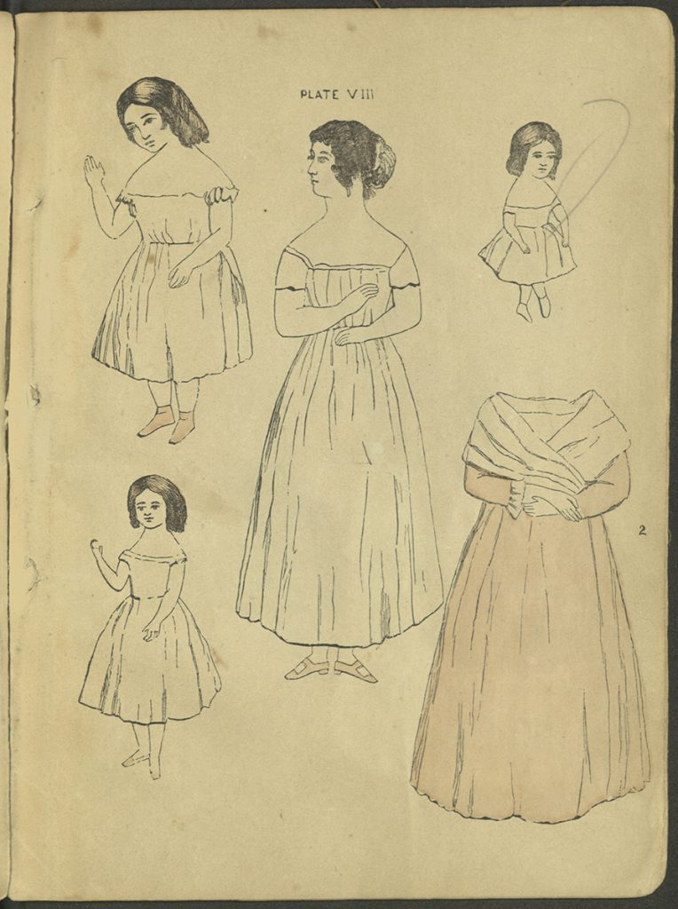 Plate VIII. Four dolls, of varying ages, and one garment